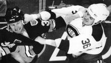 Boston Bruins Lyndon Byers, left, and Montreal Canadiens Todd Ewen, right, trade punches during a brawl in this file photo. (CP)