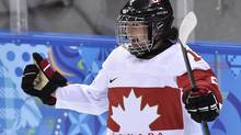Canada forward Melodie Daoust reacts after scoring against Switzerland during first period semi-final women's Olympic hockey action at the 2014 Sochi Winter Olympics in Sochi, Russia on Monday, February 17, 2014. (Nathan Denette/THE CANADIAN PRESS)