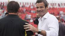 Toronto FC manager Ryan Nelsen greets the Columbus Crew before the teams compete in the MLS Trillium Cup in Toronto on Saturday, July 27, 2013. Fresh from a trip to England and Italy in search of marquee talent, Nelsen says the struggling MLS club is feeling good about the future. (Michelle Siu/THE CANADIAN PRESS)
