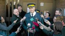 RCMP officer Tony Hamori speaks to the media about the death of a newborn infant killed by a dog in Airdrie, Alta., on Feb. 16, 2012. (Jeff McIntosh/Jeff McIntosh/THE CANADIAN PRESS)