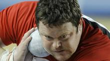 Canada's Dylan Armstrong makes an attempt at the Men's Shot Put qualification during the World Indoor Athletics Championships in Istanbul, Turkey, Friday, March 9, 2012. (Martin Meissner/AP/Martin Meissner/AP)