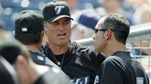 Toronto Blue Jays manager John Farrell, center, talks with his first base coach Torey Lovullo, right (Charles Krupa)