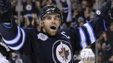 Winnipeg Jets Andrew Ladd celebrates his goal against the Dallas Stars during the second period of their NHL hockey game in Winnipeg March 14, 2012. REUTERS/Fred Greenslade (FRED GREENSLADE)