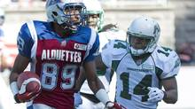 Montreal Alouettes' Duron Carter, left, breaks away from Saskatchewan Roughriders' Prince Miller to run in for a touchdown during second half CFL football action in Montreal, Sunday, September 29, 013. (GRAHAM HUGHES/THE CANADIAN PRESS)