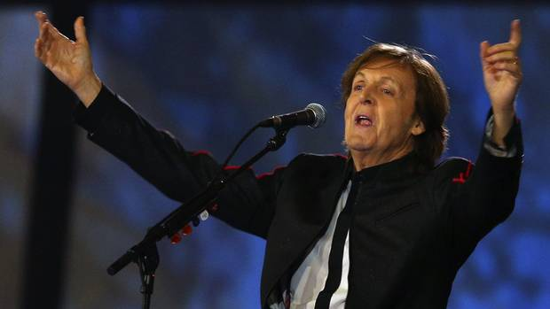 Former Beatle Paul McCartney sings during the opening ceremony of the London 2012 Olympic Games at the Olympic Stadium July 27, 2012 (Reuters)