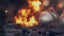 In this video image taken from Japan's NHK TV, an oil refinery burns in Ichihara, Chiba Prefecture. (AP Photo/NHK TV)