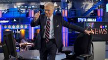 CTV News anchor Lloyd Robertson gives a thumbs-up to producers as he takes his seat for his final newscast on Sept. 1, 2011. (Chris Young/The Canadian Press)
