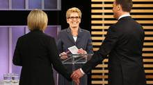 Ontario NDP leader Andrea Horwath, Ontario Premier Kathleen Wynne, centre, and Ontario Progressive Conservative leader Tim Hudak speak after taking part in the Ontario provincial leaders debate in Toronto, Tuesday June 3, 2014. (MARK BLINCH/THE CANADIAN PRESS)