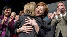 Premier-designate Christy Clark hugs her nine -year-old son, Hamish, at a the B.C. Liberal convention in Vancouver on Feb. 26, 2011. (JOHN LEHMANN/JOHN LEHMANN/THE GLOBE AND MAIL)