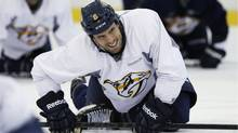 Nashville Predators defenseman and captain Shea Weber stretches during NHL hockey training camp Monday, Jan. 14, 2013, in Nashville, Tenn. (Associated Press)