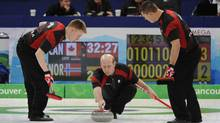 The Canadian men's curling team skipped by Kevin Martin during the gold medal match against Norway at the Vancouver Olympic Centre.Kevin Martin throwing stone with Marc Kennedy, left and Ben Hebert , right. (Fred Lum)