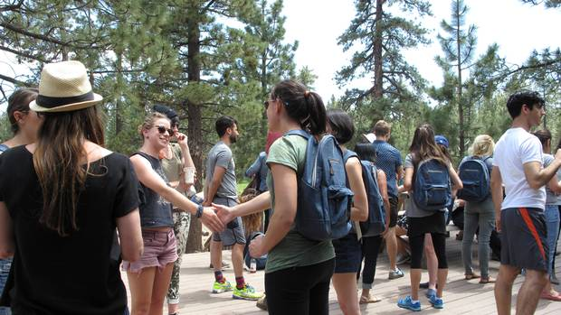 Soon after arriving, CAMPERS meeting fellow CAMPERS on the dining hall patio.