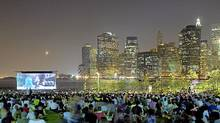 People watch the movie Monsters vs. Aliens as part of a movies-with-a-view series on Pier 1 in New York. (Etienne Frossard/Etienne Frossard)