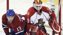 Montreal Canadiens' Michael Cammalleri (L) trips over Florida Panthers goaltender Tomas Vokoun during the second period of NHL hockey action in Montreal, October 30, 2010. REUTERS/Christinne Muschi (CHRISTINNE MUSCHI)