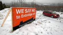 A sign showing opposition to the $5.5-billion Enbridge oil pipeline from Alberta to the northwest coast of British Columbia sits on a property in Kitimat, B.C., on Thursday Jan. 12, 2012. (DARRYL DYCK/DARRYL DYCK/THE CANADIAN PRESS)