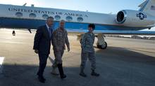 Then-U.S. Secretary of Defense Chuck Hagel, left, walks with Vice Admiral Robert Harward and Colonel Kelly Martin after landing at MacDill Air Force Base in Tampa, Fla. on March 21, 2013. (HANDOUT/REUTERS)