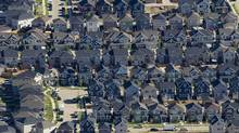 Homes are seen in this aerial photograph taken above Fort McMurray, Alberta, Canada, on Thursday, June 4, 2015. (Ben Nelms/Bloomberg)