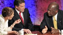 Republican presidential hopefuls Michele Bachmann, Rick Perry and Herman Cain talk during a break in their debate at Dartmouth College in Hanover, N.H., on Oct. 11, 2011. (ADAM HUNGER/REUTERS)