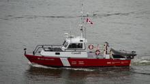 A Canadian Coast Guard vessel moves through Vancouver harbour in June 2012. (Darryl Dyck/The Canadian Press)