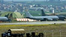 U.S. planes at Incirlik, Turkey: NATO has the planes, combat ships and bases to mount a no-fly mission against Syria. (VALDRIN XHEMAJ/AFP)