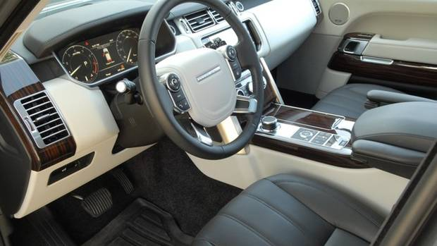 In photos 2015 Land Rover Range Rover HSE inside and out