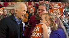 NDP Leader Jack Layton is greeted by 3-year-old Ophelia McDaid as he meets supporters during a campaign stop in Regina on March 28, 2011. (Andrew Vaughan/THE CANADIAN PRESS)