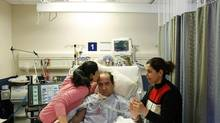 Hassan Rasouli, who recently started reacting after being in vegetative state at Sunnybrook Hospital, photographed with his daughter Majgan and wife Parichehr Salasel at the hospital on Bayview Ave.,Toronto, April 24, 2012. (Fernando Morales/The Globe and Mail)
