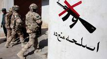 Canadian soldiers from the Provincial Reconstruction Team (PRT) walks into an Afghan police station in the center of Kandahar city, June 9 2009. (JORGE SILVA)