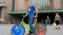 Outside the Central Station, pick up a City Bike to explore Helsinki. (Robin Esrock)