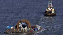 In this Nov. 2009 photo, Nova Scotia Power and OpenHydro prepared to deploy the first commercial in-stream tidal turbine in the Bay of Fundy near Parrsboro, N.S. (ANDREW VAUGHAN/The Canadian Press)