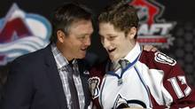 Nathan Mackinnon stands with Colorado Avalanche coach Patrick Roy after MacKinnon was selected by the Avalanche as the first overall pick in the 2013 National Hockey league (NHL) draft in Newark, New Jersey, June 30, 2013. (Reuters)