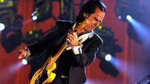 Australian singer Nick Cave performs in Germany, in June. Cave with his longtime collaborator Warren Ellis, have composed the score to the film The Road, premiering at TIFF. (NIGEL TREBLIN/2009 AFP)