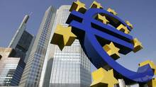 The Euro sculpture in front of the headquarters of the European Central Bank (ECB) in Frankfurt (JOHN MACDOUGALL)