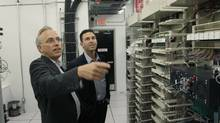 Wind Mobile CEO Ken Campbell, left, and chairman Anthony Lacavera look at the company's servers in Toronto. (Fernando Morales/Fernando Morales/The Globe and M)