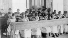 """Students sit in a classroom at St Joseph's Convent, otherwise known as the Fort Resolution Indian Residential School in Fort Resolution, Northwest Territories in an undated archive photo. A Canadian policy of forcibly separating aboriginal children from their families and sending them to residential schools amounted to """"cultural genocide,"""" a six-year investigation into the now-defunct system found on June 2, 2015. (HANDOUT/REUTERS)"""