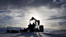 An oil pumpjack sits unused in a field North of Edmonton Alberta February 8, 2013. (Jason Franson for The Globe and Mail)