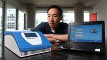 Paul Lem, CEO of Spartan poses with Spartan RX, a box the size of a shoebox that delivers DNA test results in Ottawa. (Dave Chan for The Globe and Mail)
