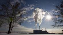 Smoke pours from the stacks at the Portlands Energy Centre in Toronto, January 15, 2009. An environmental analyst says a new report revealing that oil and gas production has become the single biggest source of greenhouse gas emissions adds further weight to calls for Ottawa to regulate the sector. (Frank Gunn/THE CANADIAN PRESS)