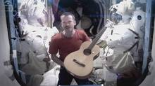 Canadian Astronaut and ISS commander Chris Hadfield performs David Bowie's Space Oddity on the International Space Station in 2013 (HO/THE CANADIAN PRESS)