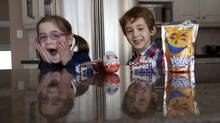The six-year-old twins of Toronto dietitian Rebecca Davids, who urges parents to commit as a group to providing healthier fare. (Moe Doiron/The Globe and Mail)