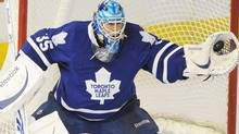 Toronto Maple Leafs goalie Jean-Sebastien Giguere makes a glove save against the Edmonton Oilers during first period NHL action in Edmonton on Tuesday, December 14, 2010. THE CANADIAN PRESS/John Ulan (John Ulan)