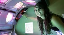 Rosie McDavid, 17, who has been using tanning beds since she was 14, prepares a tanning bed for a session, Wednesday, March 25, 2009, in Tallahassee, Fla. The Florida Legislature is considering a bill that would restrict tanning bed use by minors. (Phil Coale/AP)