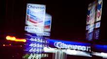 A Chevron station in Los Angeles displays its gasoline prices on March 24. In the long run, a big reduction in U.S. oil demand might make an appreciable difference to prices. (BRET HARTMAN/Bret Hartman/Reuters)