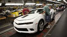 Workers at the General Motors Oshawa assembly plant work on the Camaro model. (Moe Doiron/The Globe and Mail)