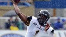 Hamilton Tiger-Cats quarterback Henry Burris throws a pass against the Winnipeg Blue Bombers during the first half of their CFL preseason game in Winnipeg, June 20, 2012. (FRED GREENSLADE/REUTERS)