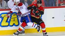 Calgary Flames defenseman Dennis Wideman (6) and Montreal Canadiens right wing Brian Gionta (21) battle for the puck during the second period at Scotiabank Saddledome. (Sergei Belski/USA Today Sports)