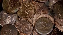 A handful of one cent coins is seen in Dartmouth, N.S, March 29, 2011. THE CANADIAN PRESS/Andrew Vaughan (Andrew Vaughan/THE CANADIAN PRESS)