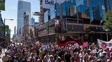People protest the fatal shooting of Sammy Yatim by police as they march toward Toronto Police Headquarters during a public protest on August 13, 2013. (Galit Rodan/THE CANADIAN PRESS)