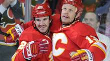 Calgary Flames' Curtis Glencross, left, celebrates his first goal against the Chicago Blackhawks with Olli Jokinen during second period NHL action, in Calgary, Alta., Friday Nov. 18, 2011. THE CANADIAN PRESS/Larry MacDougal (Larry MacDougal/CP)