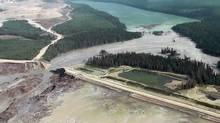 Aerial footage taken on Aug. 4, 2014, shows a breach of the dam of the Mount Polley Mine tailings pond, which spilled toxic waste water into neighbouring Hazeltine Creek and Polley Lake (top). (Cariboo Regional District)